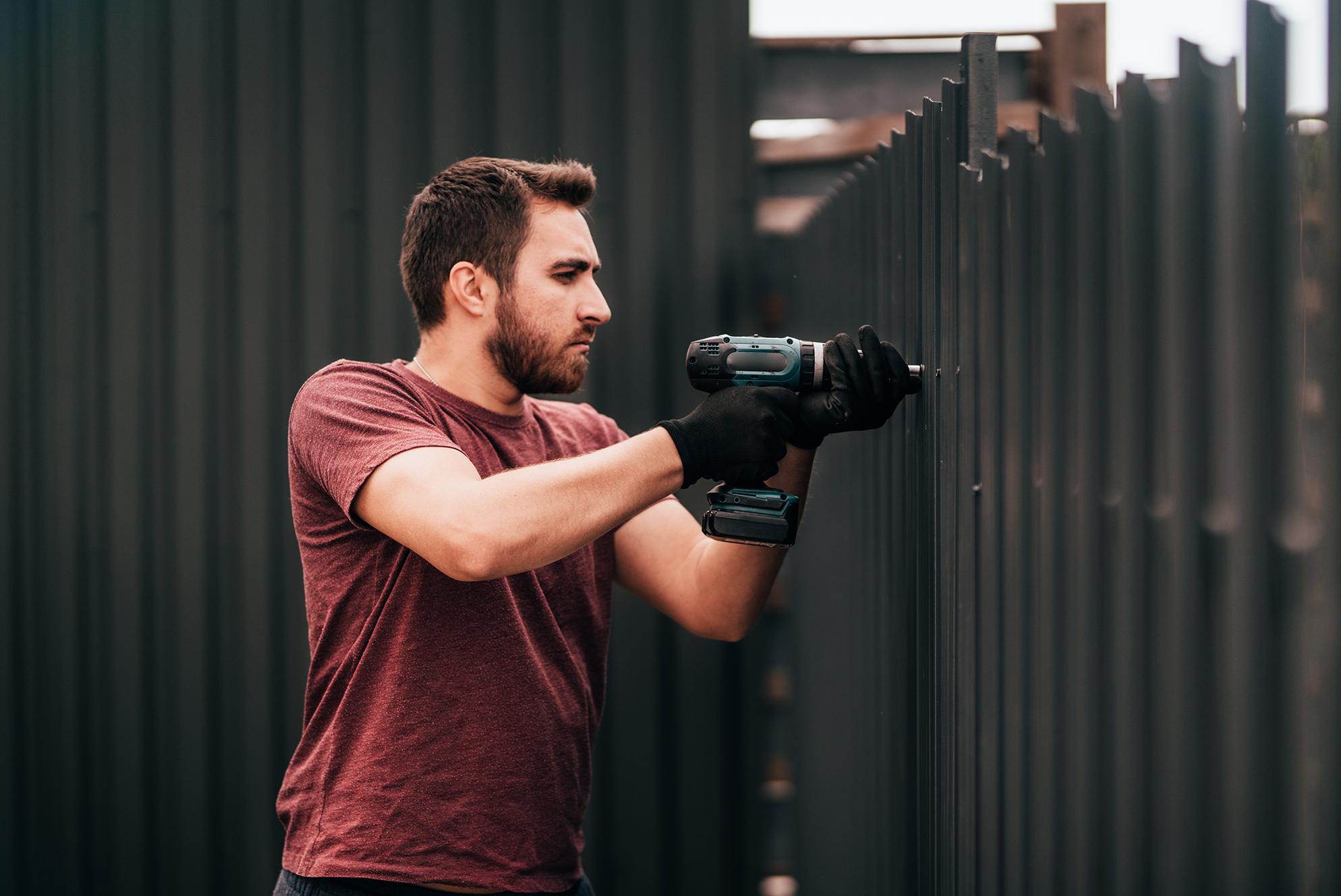 working-man-portrait-construction-worker-using-scr-ZCA3SCF